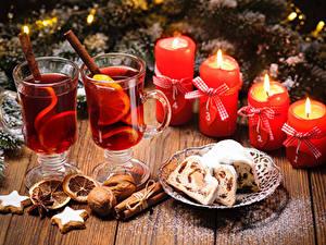 Фото Новый год Кекс Орехи Корица Свечи Напиток Печенье Доски Стакан Пища