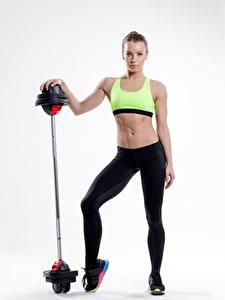 Фотографии Фитнес Штанга Сером фоне девушка Спорт