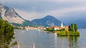 Обои Италия Горы Озеро Здания Lake Maggiore Природа