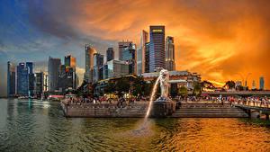 Картинки Сингапур Дома Парк Фонтаны Рассветы и закаты Лестницы Merlion Park город