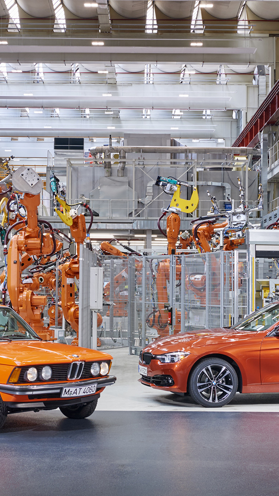 Картинки BMW 1975-2017 3 Series Завод две оранжевая Металлик Автомобили 1080x1920 для мобильного телефона БМВ фабрика 2 два Двое вдвоем Оранжевый оранжевых оранжевые авто машина машины автомобиль