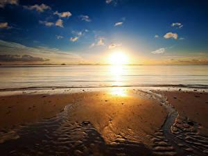 Фото Побережье Рассветы и закаты Песок Природа