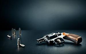 Фотографии Пистолеты Пули Серый фон Револьвер Армия