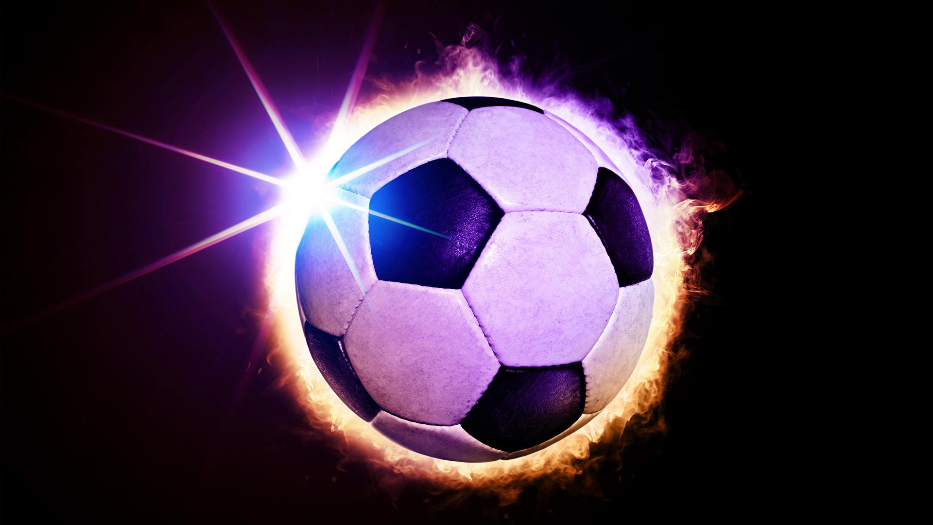 Фотографии Лучи света Футбол спортивный Мяч Черный фон 1920x1080 Спорт спортивная спортивные Мячик на черном фоне