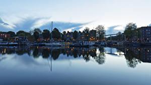 Фотография Нидерланды Амстердам Здания Реки Причалы Вечер Речные суда Города