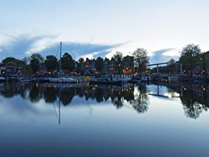 Фотография Нидерланды Амстердам Здания Реки Причалы Вечер Речные суда город