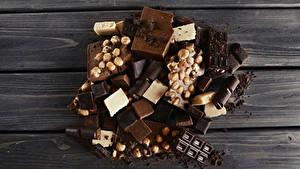 Фото Сладости Шоколад Орехи Доски Еда