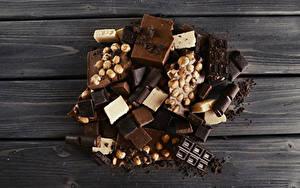 Фото Сладкая еда Шоколад Орехи Доски Еда