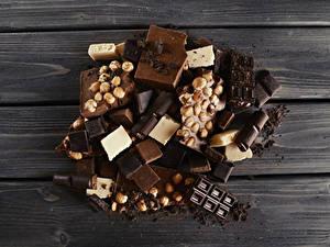 Фото Сладости Шоколад Орехи Доски