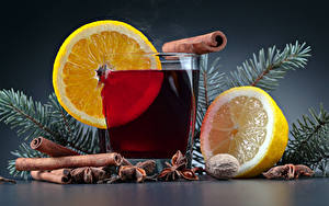 Картинки Новый год Напитки Лимоны Корица Бадьян звезда аниса Стакане Ветки Продукты питания