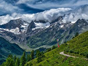 Картинка Швейцария Горы Пейзаж Альпы Облачно Природа