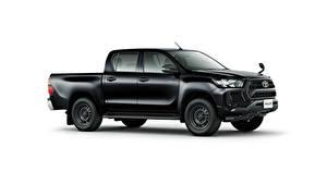 Фотографии Toyota Черные Металлик Пикап кузов Сбоку Белым фоном Hilux X Double Cab, JP-spec, 2020 авто