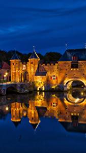 Фотография Нидерланды Крепость Мосты Здания Водный канал Ночные Уличные фонари Koppelpoort Amersfoort