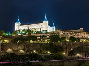 Картинки Испания Толедо Здания Дороги Дворца В ночи Уличные фонари Real Alcazar Seville город