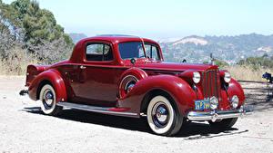 Картинки Ретро Бордовый Металлик 1939 Packard Twelve 2-4-passenger Coupe автомобиль