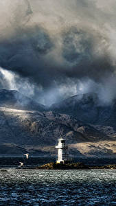Фотографии Шотландия Маяки Горы Вечер Море Берег Облака Argyle Природа