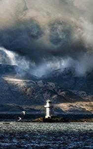 Фотографии Шотландия Маяки Гора Вечер Море Берег Облачно Argyle Природа