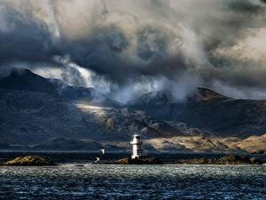 Фотографии Шотландия Маяки Горы Вечер Море Берег Облачно Argyle Природа