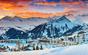 Фото Франция Курорты Дома Горы Зимние Альпы Снегу Облако Le Corbier город