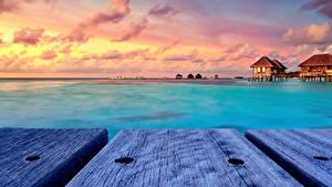 Обои Мальдивы Тропики Рассвет и закат Бунгало Доски Природа