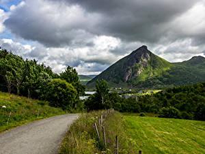 Картинки Норвегия Лофотенские острова Горы Леса Дороги Облака Природа