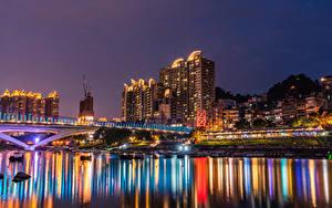 Фото Тайвань Здания Река Мосты Пристань Ночь Лучи света New Taipei