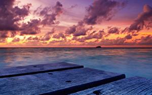 Фото Мальдивы Тропический Море Рассветы и закаты Небо Пирсы Облачно Природа