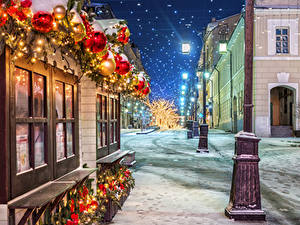 Фотографии Москва Рождество Россия Зима Снегу Улице Уличные фонари Ночью Manezhnaya Square Города