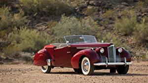Фотография Ретро Бордовые Металлик 1940 Packard 120 Convertible Victoria by Darrin Автомобили