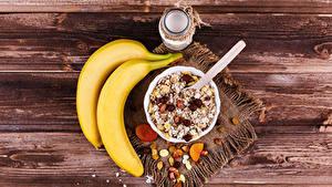 Фотография Бананы Мюсли Изюм Доски Завтрак Банка