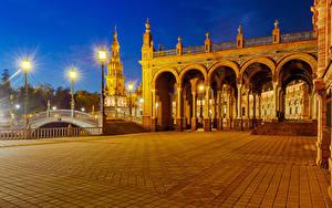 Фотография Испания Дома Мосты Городской площади Ночь Уличные фонари Seville Spanish Square город