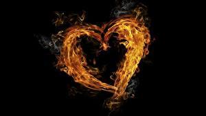 Фотографии Огонь Серце На черном фоне