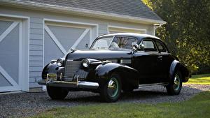 Фото Cadillac Ретро Черная Металлик 1940 Sixty-Two Coupe автомобиль