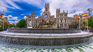 Картинки Испания Мадрид Здания Фонтаны Скульптуры Вода Флага Cybeles Square Города