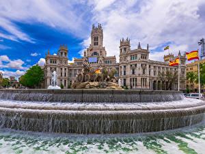 Картинки Испания Мадрид Здания Фонтаны Скульптура Воде Флага Cybeles Square Города