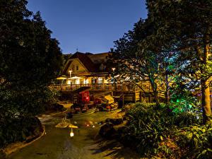 Картинки Япония Диснейленд Парк Здания Пруд Дизайн Ночь Деревьев Природа