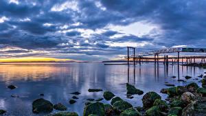 Картинка Канада Пейзаж Побережье Рассветы и закаты Камни Небо Пристань Мох Облака Природа