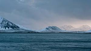 Фотографии Исландия Горы Река Зимние Природа