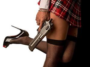 Фотографии Пистолеты Крупным планом Чулках Ноги Юбки Туфлях Белом фоне девушка