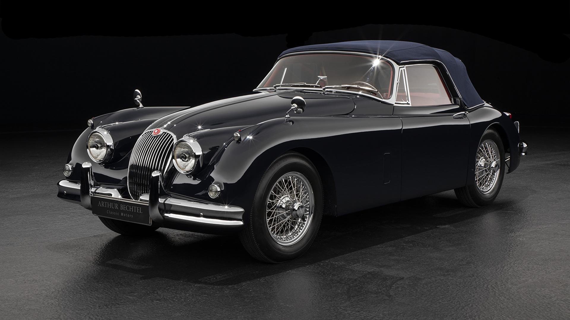 Фотографии Ягуар 1958-61 XK150 Drophead Coupe Купе Ретро Черный Металлик автомобиль Серый фон 1920x1080 Jaguar черных черные черная Винтаж старинные авто машина машины Автомобили сером фоне