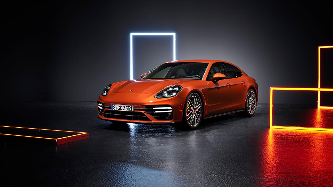 Фото Порше Panamera Turbo S (971), 2020 оранжевые машина Металлик 1366x768 Porsche оранжевая Оранжевый оранжевых авто машины Автомобили автомобиль