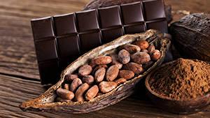 Картинка Сладкая еда Шоколад Орехи Шоколадка Доски Какао порошок