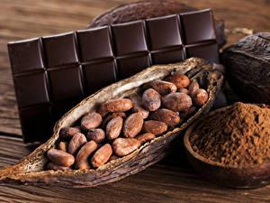 Картинка Сладкая еда Шоколад Орехи Шоколадка Доски Какао порошок Пища