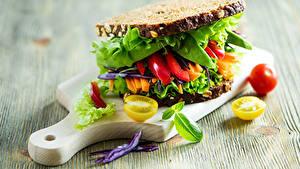 Фото Бутерброды Хлеб Овощи Сэндвич Разделочная доска