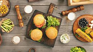 Фото Сэндвич Булочки Овощи Оливки Кукуруза Доски Разделочная доска Еда