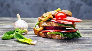 Картинки Сэндвич Овощи Чеснок Хлеб Колбаса Продукты питания