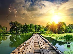Картинка Реки Мост Рассвет и закат Небо Молния