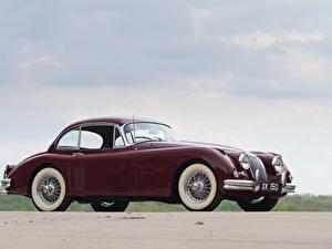 Фотографии Jaguar Темно красный Металлик 1958-61 Jaguar XK150 Fixed Head Coupe автомобиль