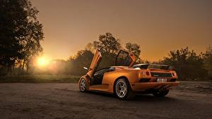 Обои для рабочего стола Рассветы и закаты Оранжевых Сзади Открытая дверь Diablo VT by Arnoldas Ivanauskas автомобиль