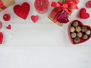 Фото Конфеты Свечи Роза Сердечко Бантики Пища